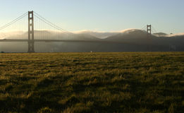 Golden Gate bridge at Dusk with fog coming. Over the hills of Marin County Royalty Free Stock Photo