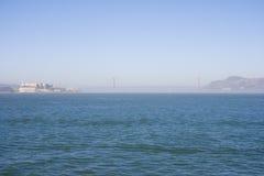 Golden Gate Bridge on a early morning. View to Golden Gate Bridge with Alcatraz Island on foreground. California, USA stock photos