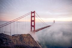 The golden Gate bridge engulfed in Fog. This picture shows The golden Gate bridge engulfed in Fog stock image