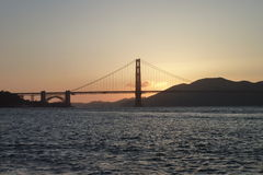 Golden Gate Bridge in the evening. Golden Gate Bridge with a sunset and water Royalty Free Stock Images