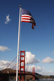 Golden Gate Bridge with Flag Royalty Free Stock Images