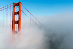 Golden Gate Bridge in Fog. Golden gate bridge in low fog on a breezy summer day Royalty Free Stock Photography