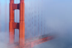 Golden Gate Bridge in Fog. Golden gate bridge in low fog on a breezy summer day Royalty Free Stock Photos