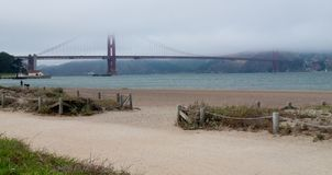 Golden Gate Bridge in Fog. View from Crissy Field in San Francisco stock photography