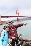 Golden gate bridge - happy biking couple portrait Royalty Free Stock Photo