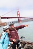 Golden gate bridge - happy biking couple portrait Royalty Free Stock Photo