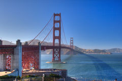 The golden gate bridge and its shadow. The Golden Gate bridge with its shadow projected onto the ocean royalty free stock photography