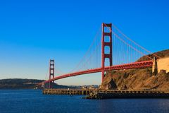 Golden Gate Bridge just after sunrise. Seen from Marin County side Royalty Free Stock Photography