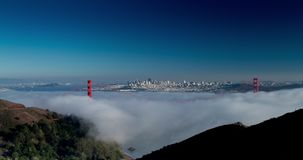 Golden Gate Bridge Low Fog. Low Fog Under Golden Gate Bridge. San Francisco Skyline in the Background stock video
