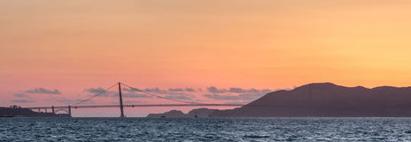 Golden Gate Bridge and Marin Hills Panorama Sunset. Looking North towards the Marin Headlands from Treasure Island, San Francisco, California, USA Stock Images