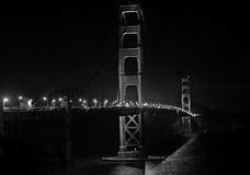Golden Gate Bridge at night, B&W. A black and white view of the golden gate bridge. High contrast Royalty Free Stock Photography