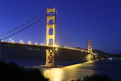 Golden Gate Bridge at night. The beautiful Golden Gate bridge at nighttime. Clear blue sky Royalty Free Stock Photography