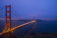 Golden Gate Bridge night scene. Golden Gate Bridge sunset evening with lights of San Francisco California in background Royalty Free Stock Images