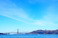 Golden Gate Bridge over the bay in San Francisco, California. The Golden Gate Bridge, a California landmark, next to mountains and over the San Francisco Bay on Royalty Free Stock Images