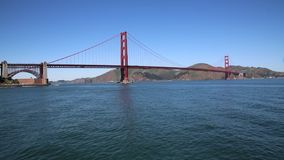 Golden Gate Bridge over blue wate stock video footage