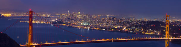 Golden Gate Bridge over San Francisco Bay. And Skyline at Dusk Panorama royalty free stock image