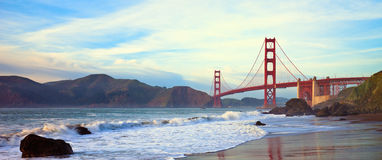 Golden Gate Bridge Panorama. Golden Gate bridge at sunset seen from Marshall Beach, San Francisco Stock Photo