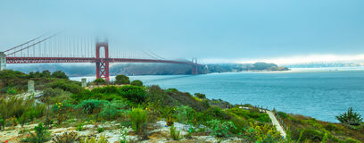 Golden Gate Bridge Panorama. Panorama of Golden Gate Bridge with green grass as foreground from south shore. Symbol, icon and landmark of San Francisco Stock Photography