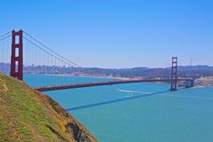 Golden Gate Bridge. From the park with blue skies and City of San Francisco in the background stock image