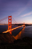 Golden Gate Bridge reflection illuminated city skyline twilight Stock Photo