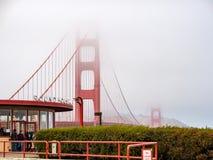 Golden Gate Bridge and Roundhouse Cafe peeking through fog stock photo