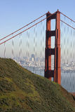 Golden gate bridge, san francisco. Vertical shot of the Golden Gate bridge in San Francisco, California. You can see the skyline of the city in the background Royalty Free Stock Images