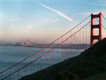 Golden Gate Bridge with San Francisco background. Golden Gate bridge towering over the bay and San Francisco. Afternoon sun Royalty Free Stock Photography
