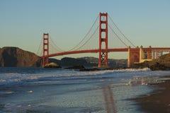 Golden Gate Bridge San Francisco from Baker Beach. Golden Gate Bridge in San Francisco reflected in the surf on Baker Beach Royalty Free Stock Photos