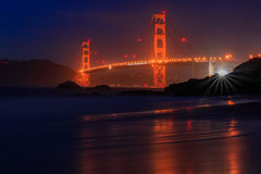 Golden Gate Bridge in San Francisco from Baker Beach at sunset Stock Image