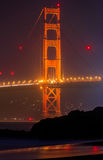 Golden Gate Bridge in San Francisco from Baker Beach at sunset Royalty Free Stock Photography