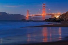 Golden Gate Bridge in San Francisco from Baker Beach at sunset Stock Image