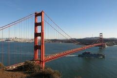 Golden Gate Bridge San Francisco Bay California. A ship passes through the San Francisco Bay beneath the Golden Gate Bridge, viewed from Fort Baker's Battery Royalty Free Stock Photos