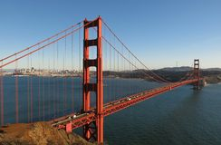 Golden Gate Bridge San Francisco Bay. The Golden Gate Bridge, viewed from Fort Baker's Battery Spencer, stretches out across the San Francisco Bay on a cloudless Stock Image