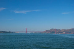 The Golden Gate Bridge in San Francisco with beautiful azure ocean and clouds in background royalty free stock image