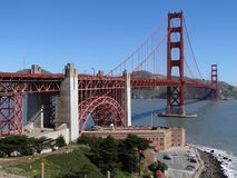 Golden Gate Bridge in San Francisco, California with Framing Trees, Mountains and Blue Sky Stock Images