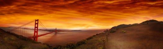 Golden Gate Bridge, San Francisco, California at sunset. Orange skies and clouds over Golden Gate Bridge in San Francisco, California at sunset with landscape stock image