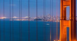 Golden Gate Bridge and San Francisco city skyline in the night Stock Photos