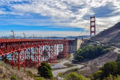 Golden Gate Bridge and San Francisco Cityscape from Marin Headlands. View of the Golden Gate Bridge and the City of San Francisco in the background. A road in stock images