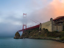 Golden Gate Bridge. San Francisco. The famous bridge which is half-covered with fog Stock Photos