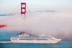 Golden Gate Bridge, San Francisco on foggy day, Cruise ship pass royalty free stock image
