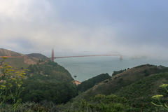 Golden Gate Bridge in San Francisco almost invisible due to heavy fog royalty free stock photography