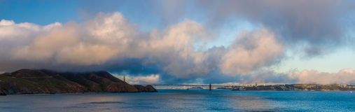 Golden Gate Bridge and San Francisco. Panorama of the bridge and city. Great clouds in the sky Royalty Free Stock Photography