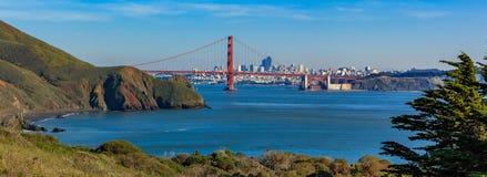 Golden Gate bridge and San Francisco skyline royalty free stock photography