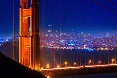 Golden Gate Bridge San Francisco sunset through cables Royalty Free Stock Image