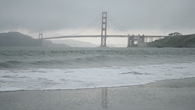 Golden Gate Bridge in San Francisco, travel,. Golden Gate Bridge in San Francisco under fog and ocean waves stock video footage