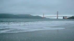 Golden Gate Bridge in San Francisco, travel,. Golden Gate Bridge in San Francisco under fog and ocean waves stock video