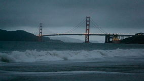 Golden Gate Bridge in San Francisco, travel,. Golden Gate Bridge in San Francisco under fog and ocean waves stock footage