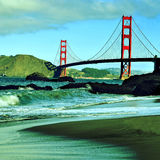 Golden Gate Bridge, San Francisco, United States. A view of Golden Gate Bridge from Baker Beach in San Francisco, United States, with a retro effect stock images