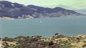 Golden Gate Bridge Sausalito. Archival aerial view from Golden Gate Bridge of the Presidio Yacht Club in Horseshoe Bay, Sausalito, California, United States in stock video footage