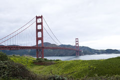 Golden Gate Bridge. Scenic view of Golden Gate Bridge with green fields in foreground, San Francisco, California, U.S.A Royalty Free Stock Images